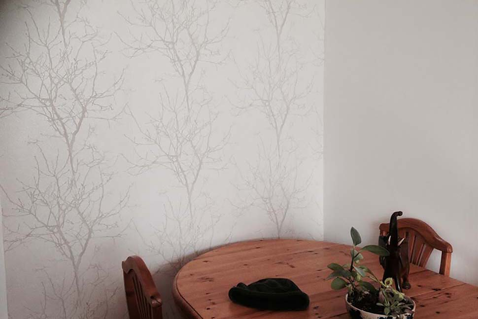 White wallpaper with silver trees